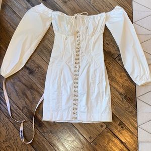White fitted dress off the shoulder